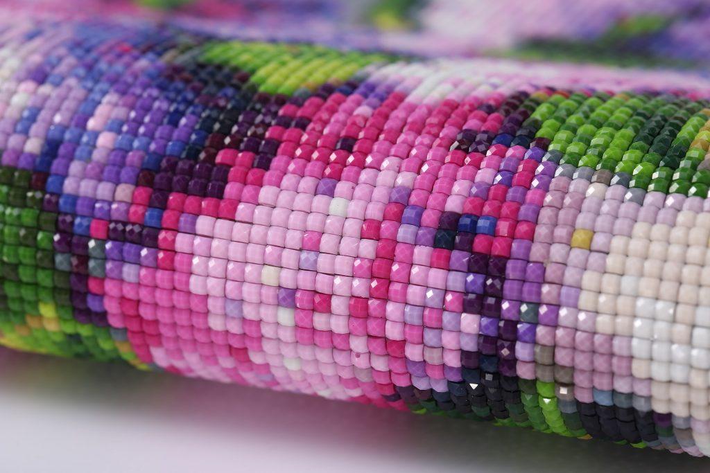 Close-up of diamond art drills on canvas